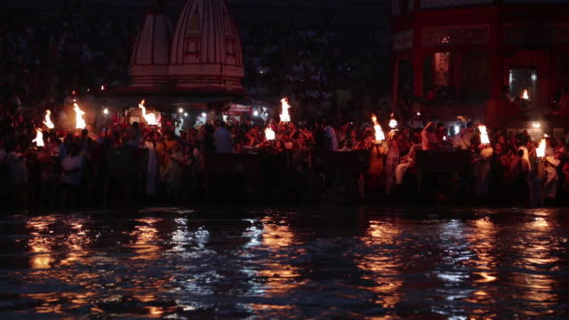 Pilgrims doing aarti of river at night, Ganges River, Haridwar, Uttarakhand, India