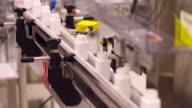 Pill Bottles Moving Along a Conveyer Belt