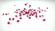 Pill capsules falling