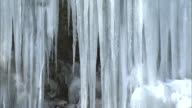 Pillars of ice hang from a frozen waterfall in Japan.
