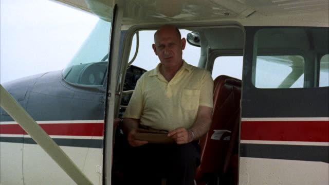 CU Pilot (John Glenn) getting out of airplane