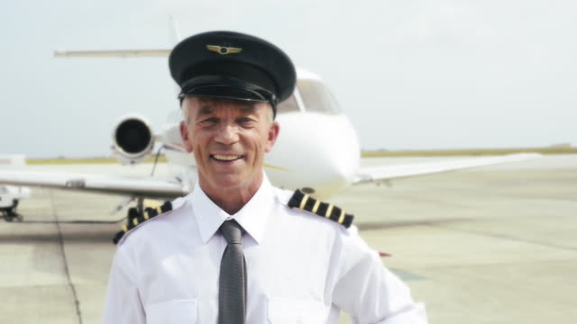 Pilot outside of private jet