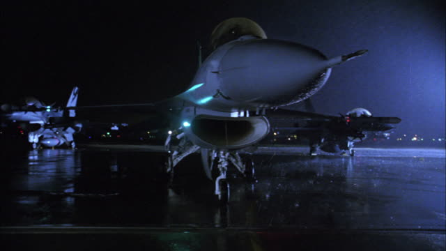 MS, CS, ZI, CU, Pilot sitting in stationary fighter jet at night, USA