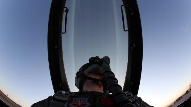 LA F-16 pilot watching cockpit door close and seal, Aurora, Colorado, USA