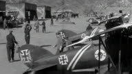 MS Pilots and mechanics preparing airplanes on field
