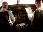 Pilots fly the first commercial flight of the new Boeing 747 from New York to London