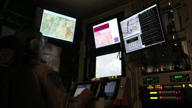Pilots in the flight operations center control the Predator from the ground US Air And Marine Predator Drones Launch For Missions Overlooking...