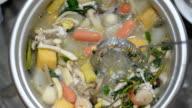 pinch food in Sukiyaki with dipper