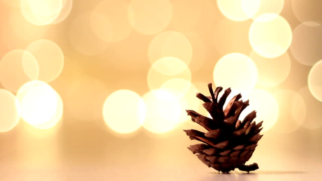 Pine cone on a New year background.