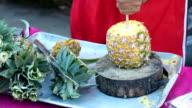 Pineapple fruit cut on wooden block