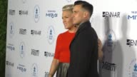 Pink and Carey Hart at the Autism Speaks To Los Angeles Celebrity Chef Gala at Barker Hangar on October 08 2015 in Los Angeles California