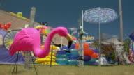 CU, Pink flamingo plastic lawn ornament in front of highway side tourist trinket shop, Wellfleet, Massachusetts, USA
