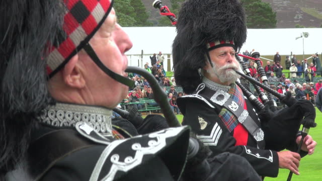 CU Pipe band performing at braemar royal highland games / Braemar, Aberdeenshire, Scotland