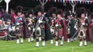 MS Pipe band performing at braemar royal highland games / Braemar, Aberdeenshire, Scotland