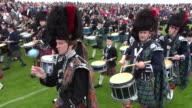 MS PAN Pipe band performing at braemar royal highland games / Braemar, Aberdeenshire, Scotland