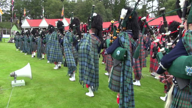 MS POV Pipe band performing at braemar royal highland games / Braemar, Aberdeenshire, Scotland