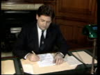 Legal and financial implications TX London The Treasury TCMS Chancellor Nigel Lawson MP sitting at desk writing CMS Lawson TILT DOWN to papers on...