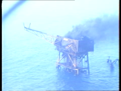background N SEA TMS Piper Alpha rig as black smoke rises NAT