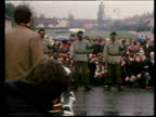 Piper leads funeral procession of hunger striker Bobby Sands masked IRA members fire gun salute over coffin draped in Irish tricolour Northern...