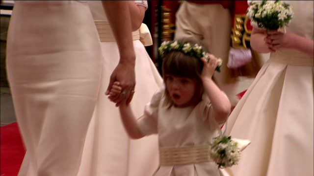 Pippa Middleton and the younger bridesmaids and page boys walk along a red carpet to the entrance of Westminster Abbey Available in HD