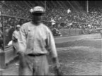 Pitcher Carl Mays throwing baseball CU George Herman 'Babe' Ruth CU Babe Ruth's hands holding bat TD MS Baseball player's feet