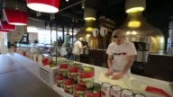 Pizza chefs use a wood fired oven inside the new Eataly food store operated by Eataly Net Srl at the Kievsky shopping mall in Moscow Russia on Sunday...