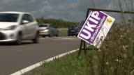 A UKIP placard hanging next to a road