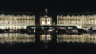 WS PAN Place de la Bourse with tram and traffic in foreground at night / Bordeaux, Aquitaine, France.