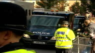 Three more appear in court ENGLAND London City of Westminster Magistrates Court EXT Police vans arrive at court PAN