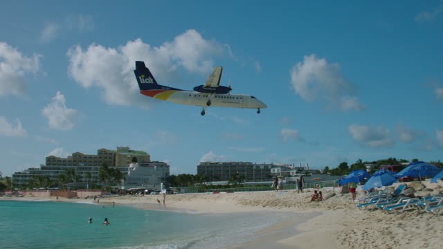 WS TS LIAT plane flying over Maho beach / St. Maarten