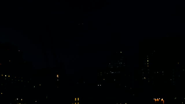 Plane flying over New York residential area at night
