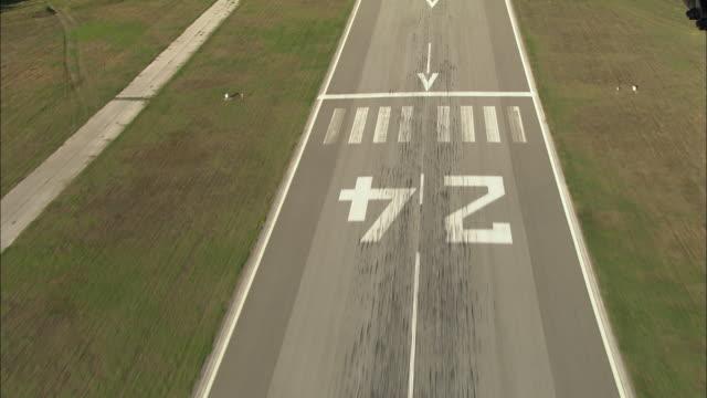 AERIAL REAR POV plane landing at the Aeroport International Saint-Tropez/ La Mole, France
