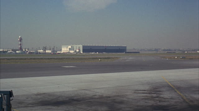 WS Plane moving on runway / Los Angeles, California, United States