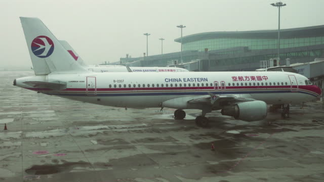Plane parked at airport gates /Xi'an, Shaanxi, China.