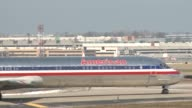Planes deliver cargo to St Louis airport/ Ground crews ready American Airlines flight for takeoff/ Flight takes off