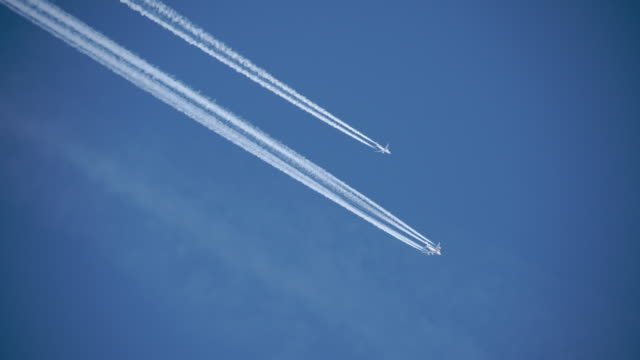 Planes flying in formation on a clear day