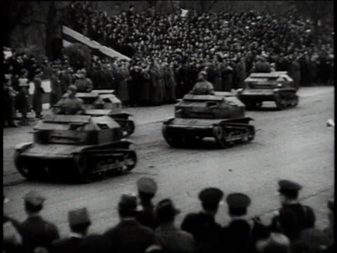 planes flying overhead / tanks driving in parade / artillery and troops marching / convoy of trucks driving