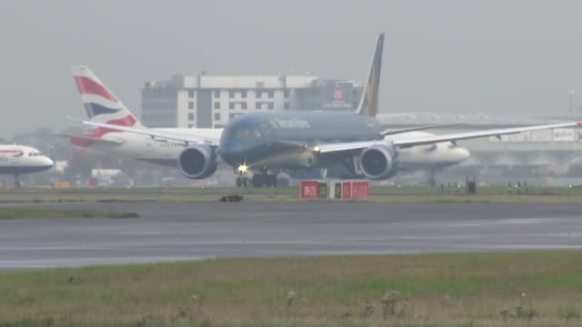 Planes taking off and Willie Walsh interview ENGLAND London Heathrow Airport EXT General views of planes taxiing and taking off at airport Eurowings...