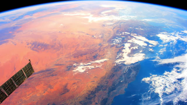 Planet Earth from Space: high color contrast between land (orange color) and water (blue color) parts of our home planet