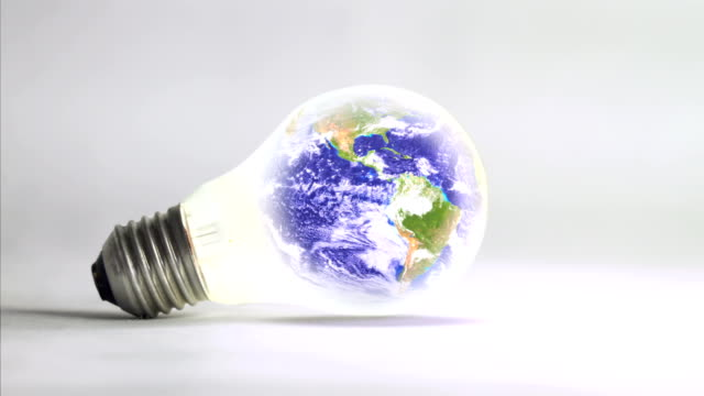 Planet Earth rotating inside a light bulb - loop. HD