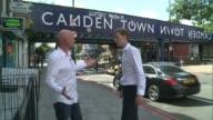 London Camden EXT Simon Pitkeathley interview SOT Close shot 'Tow' sign on bridge 'Camden Town' sign on bridge