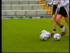 Plans to promote women's football ITN London Fulham Craven Cottage Woman player running towards across pitch LMS line of women footballers dribbling...