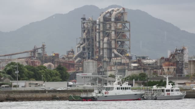 A plant stands in the Shunan industrial complex in Shunan Yamaguchi Prefecture Japan on Monday July 20 2015 Shots wide shot of the plant standing...