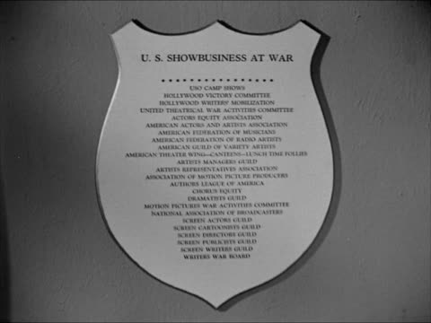 Plaque w/ showbusiness organizations working w/ war effort CU Plaque listing Federations Guilds Associations WWII