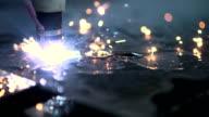 Plasma laser cutting metal sheet with sparks