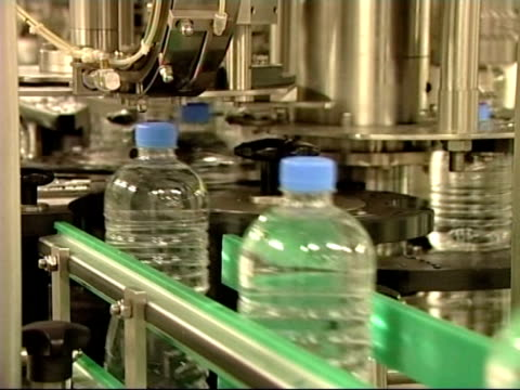 Plastic Bottles in Factory on Conveyor Belt Production