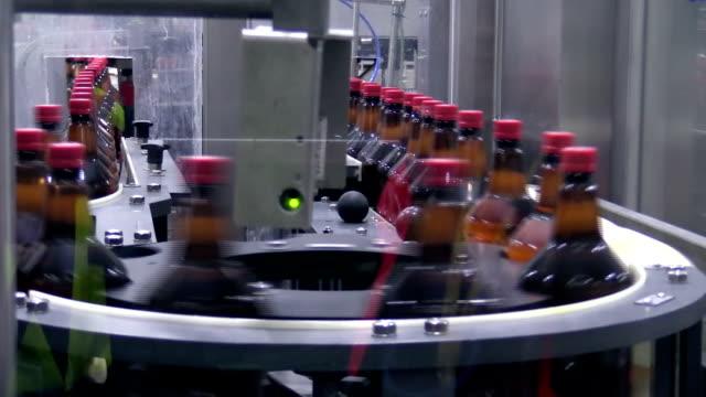Plastic bottles on conveyer belt in factory