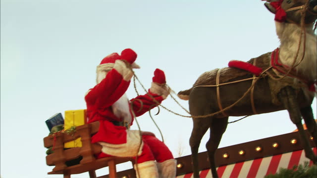 MS PAN Plastic Santa and reindeer decoration on rooftop / Nuremberg, Bavaria, Germany