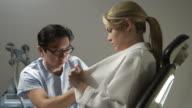 MS, Plastic surgeon marking patient's breast for breast enlargement surgery, Sydney, Australia