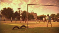 SLO MO, WS, PAN, player scoring penalty kick on field at sunset, Buenos Aires, Argentina